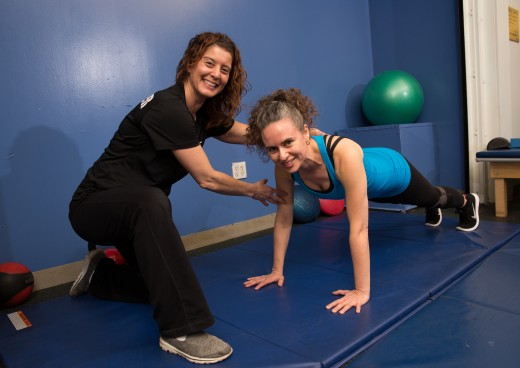 Female personal trainer with client at JCC