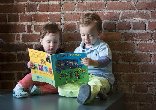 two boys reading book