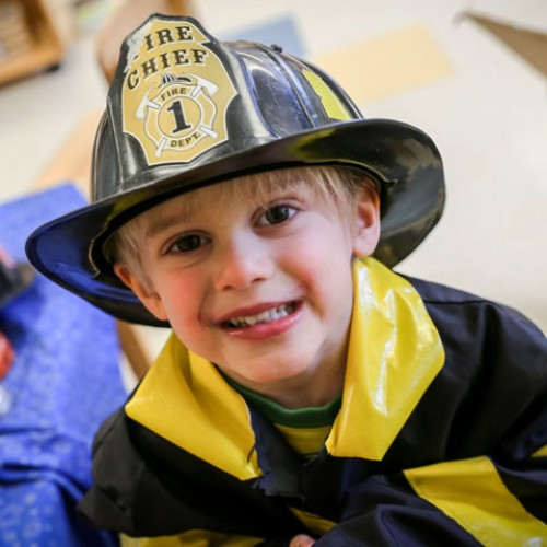 Child in a fire chief hat