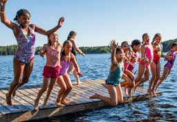 Kingswood campers jumping in the lake