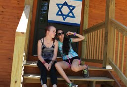 Kingswood campers hanging out in front of Israeli flag