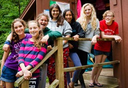 Kingswood female campers in front of bunk