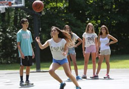 Kingswood camper playing basketball