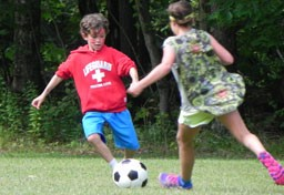 Kingswood campers playing soccer