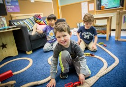 Preschool children playing with trains