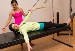 Pilates instructor and participant