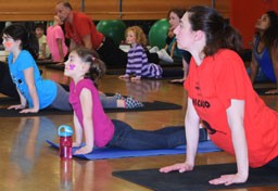 Mother and child at family yoga