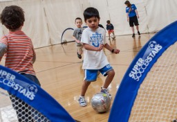 Boy playing soccer at JCC