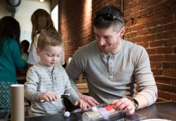 Father and son doing crafts