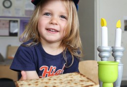 Child holding matzah in JCC preschool