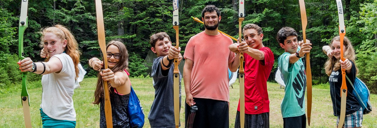 Campers learning about archery