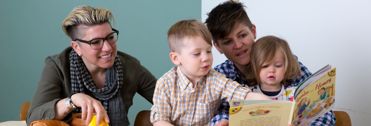 Family reading PJ Library book